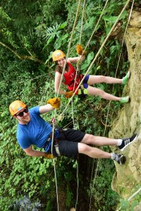Rappelling into Tres Reyes cenote