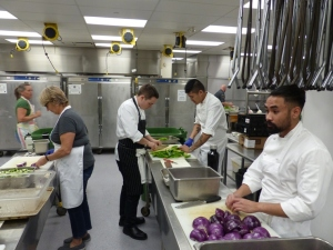 Volunteers prepare vegetables