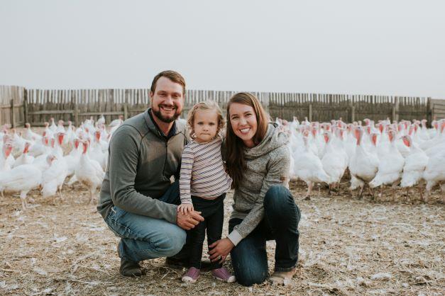 Winter family w their turkey flock